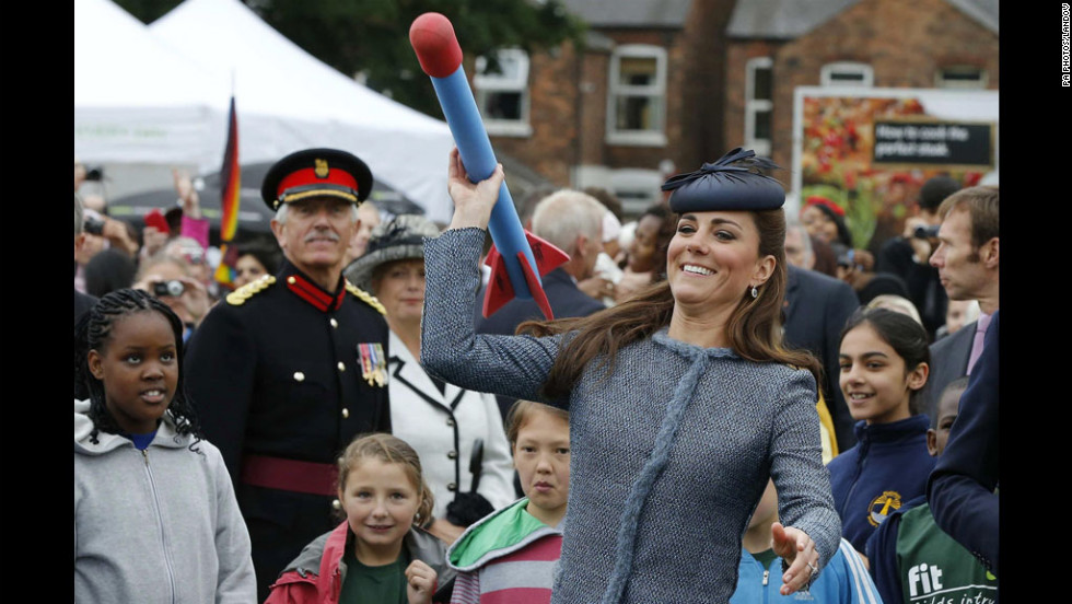 Catherine, the Duchess of Cambridge, throws a foam javelin at a children's sports event during her visit Wednesday to Vernon Park in Nottingham, England.