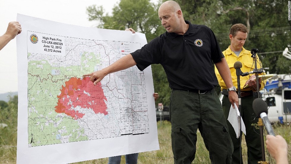 Steve Segin of the U.S. Forest Service shows a map of the size and location of the northern Colorado blaze Tuesday, June 12, in Laporte, Colorado.