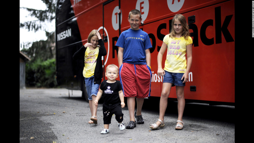 Armstrong's son Luke; his twin daughters, Isabelle and Grace; and his 1-year-old son, Max, stand outside the Radio Shack team bus on a rest day during the 2010 Tour de France.