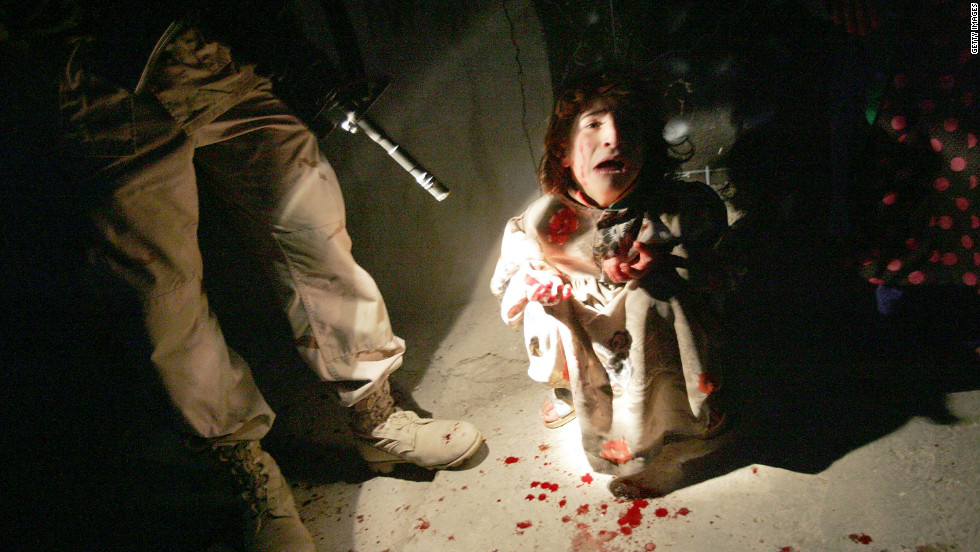 Samar Hassan screams after her parents were killed by U.S. Soldiers in a shooting on January 18, 2005 in Tal Afar, Iraq. The invasion of Iraq by U.S.-led forces ushered in a bloody new era for the country.