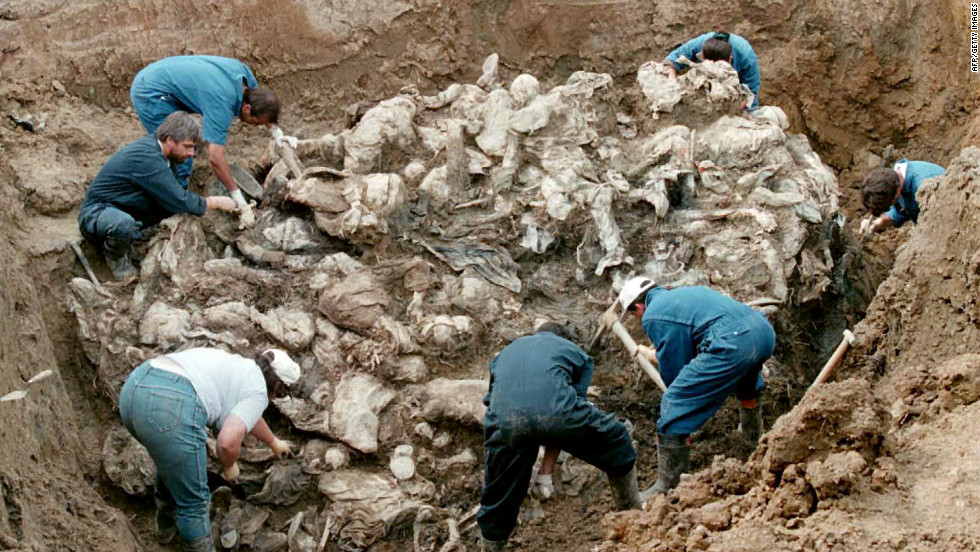 Forensic experts excavate bodies, many of them blindfolded with hands tied, outside the Bosnian village of Pilica. They were thought to be the bodies of Muslim men fleeing Serb forces during the Balkan conflict.