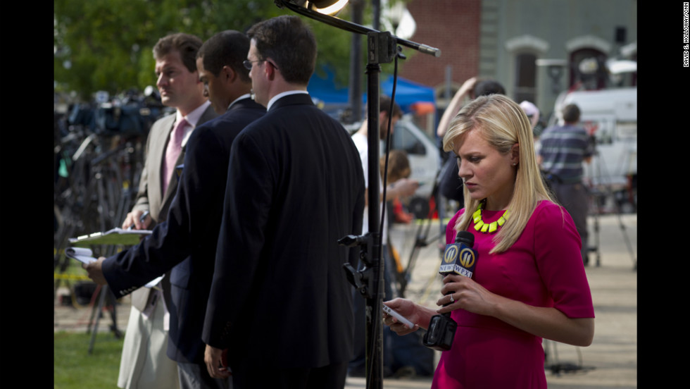 Reporters wait with microphones outside of the Sandusky trial.
