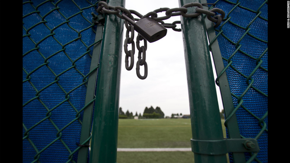 The gate to the practice football field is locked at the Mildred and Louis Lasch Football Building at Penn State University in State College, Pennsylvania