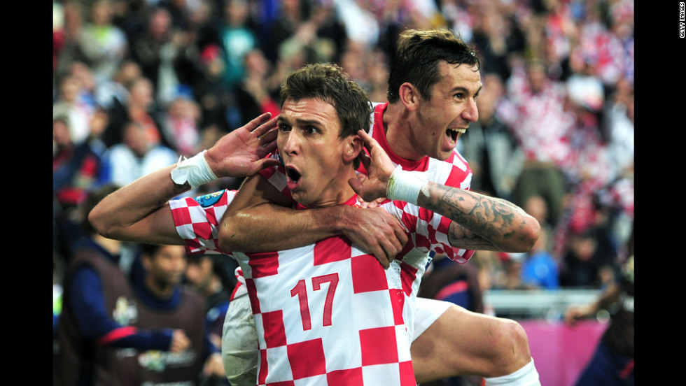 Croatia's Mario Mandzukic and his teammate Darijo Sma celebrate the team's game-tying goal against Italy in Poznan, Poland, on Thursday, June 14.
