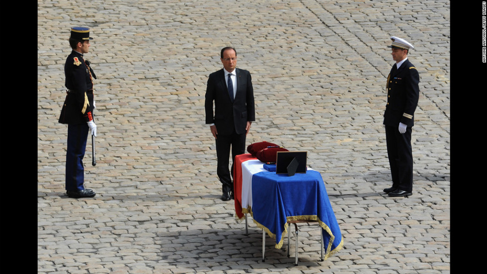French President Francois Hollande takes part in a Paris ceremony Thursday honoring four French soldiers who were killed in a suicide bombing in Afghanistan. Hollande has declared that he plans to withdraw French troops from Afghanistan in the coming weeks.