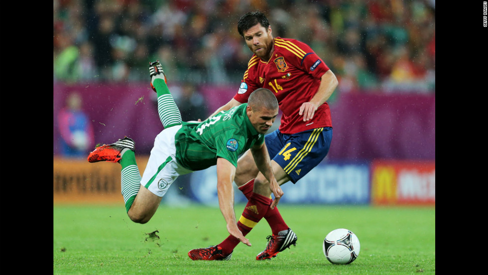 Jonathan Walters of Republic of Ireland clashes with Xabi Alonso of Spain during the match between Spain and Ireland.