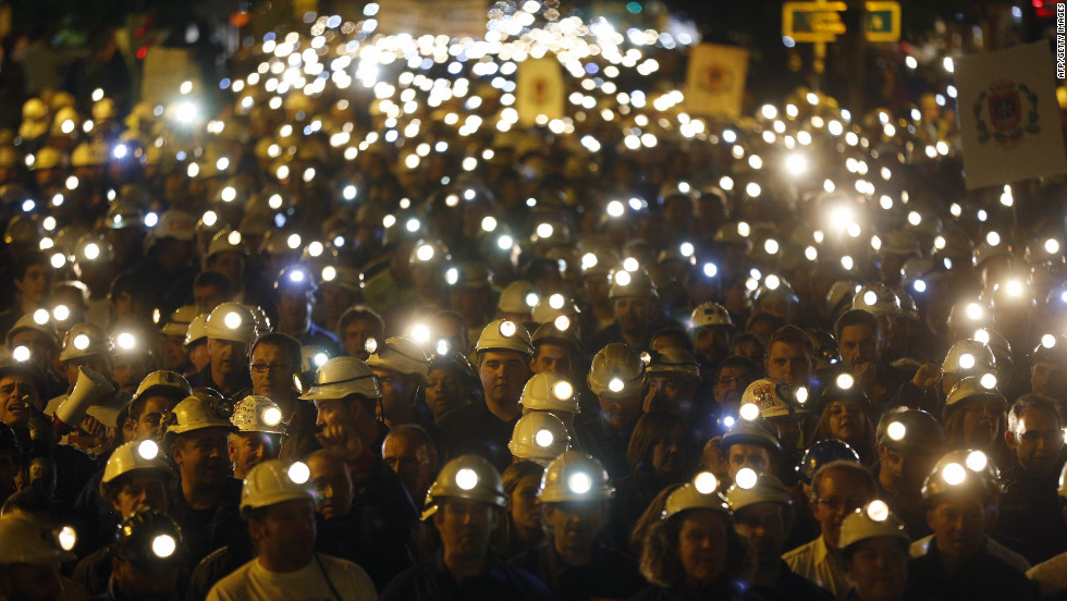 The streets of Leon in northern Spain light up as thousands of coal miners march with their helmet lights on. The protest on June 12, 2012 was part of a nationwide miners' strike against subsidy reductions.