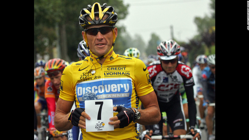 Armstrong holds up a paper displaying the number seven at the start of the Tour de France in 2005. He went on to win his seventh consecutive Tour de France.
