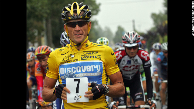 Armstrong holds up a paper displaying the number seven at the start of the Tour de France in 2005. He went on to his seventh consecutive victory.
