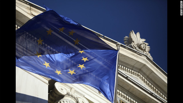 A European Union flag flies outside the National Bank of Greece SA in Athens, Greece.