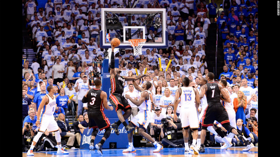 The Heat's LeBron James goes up for a shot against the Thunder's Serge Ibaka in the second quarter.