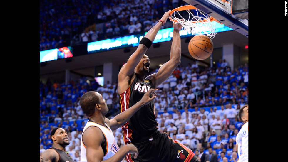 The Heat's Chris Bosh dunks the ball over the Thunder's Serge Ibaka during the fourth quarter.