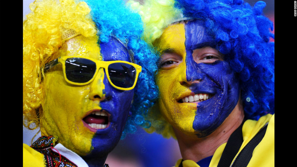 Painted Ukraine fans enjoy themselves before the Euro 2012 group D match between Ukraine and France.
