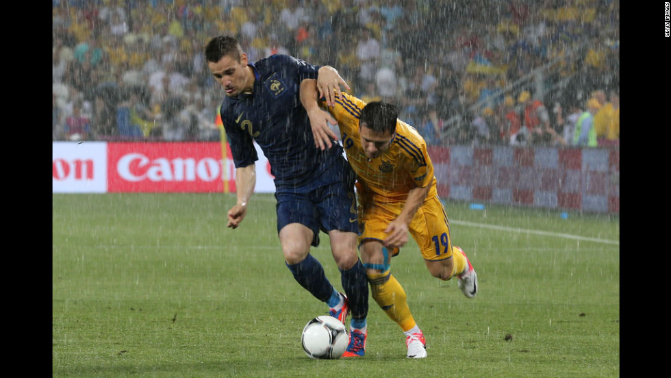 Ukraine's Yevhen Konoplyanka, right, battles France's Mathieu Debuchy for control of the ball Friday in a group D match.