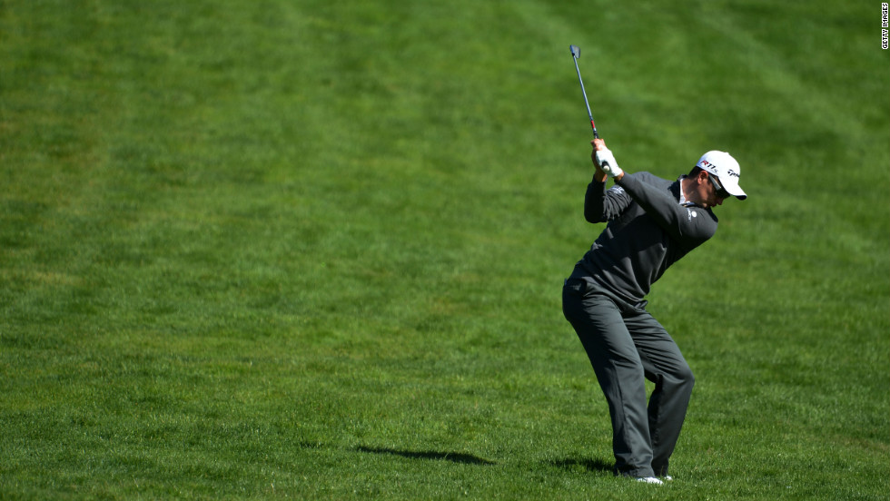 Justin Rose of England hits an approach shot on the fourth hole.