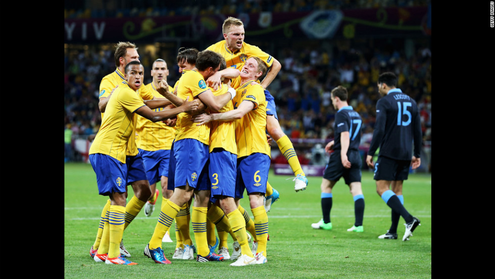Sweden celebrates after Olof Mellberg of Sweden scored its first goal during the match between Sweden and England.