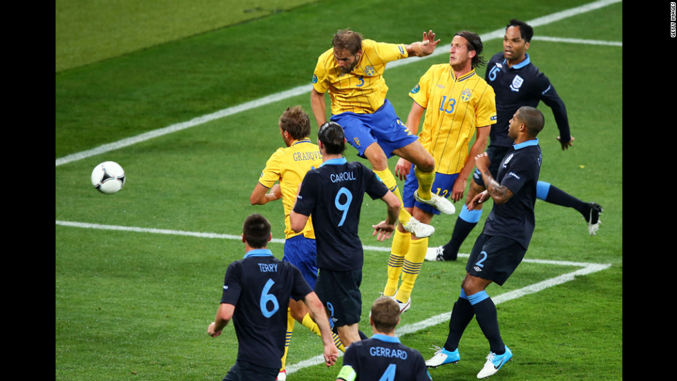 Olof Mellberg of Sweden scores Sweden's second goal against England in the Sweden-England matchup.