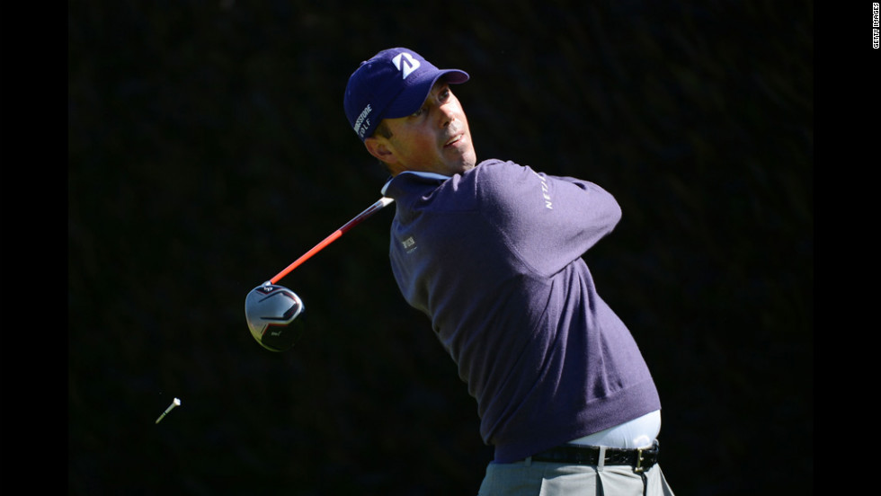 Matt Kuchar of the United States watches his tee shot on the first hole.