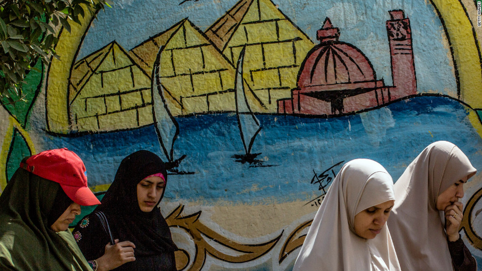 Egyptian women line up to cast their vote Saturday.