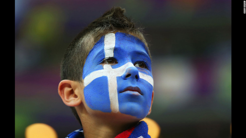 A Greece fan enjoys the atmosphere ahead of the match between Greece and Russia.