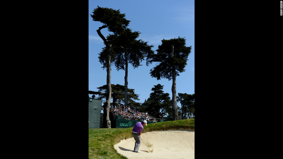 Graeme McDowell of Northern Ireland hits a bunker shot on the fifth hole during the third round.