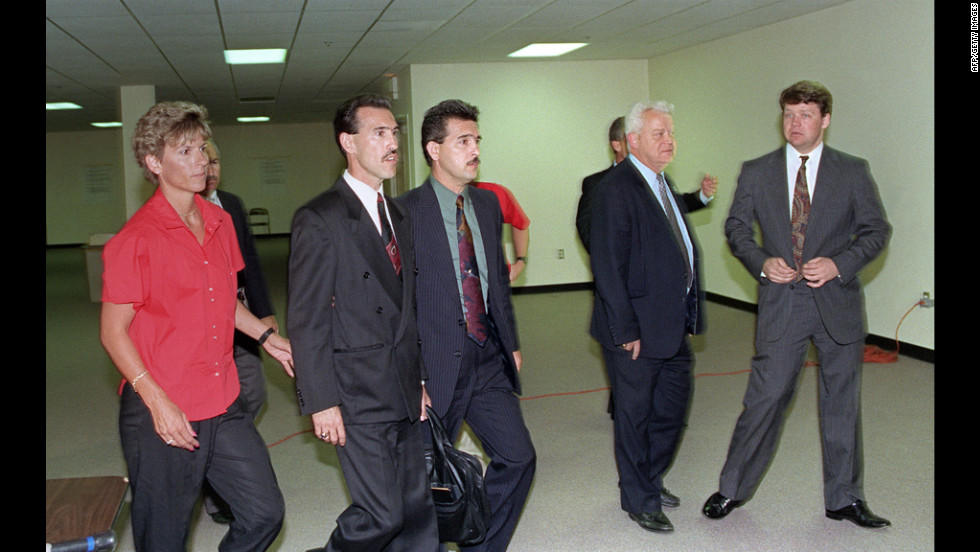 Officers Theodore J. Briseno, second from left, is escorted out of the courthouse on April 29, 1992 after being acquitted of all charges. Laurence M. Powell, right, was acquitted of all but one charge. Hours after the officers' acquittal, rioting and looting broke out in South Central Los Angeles.