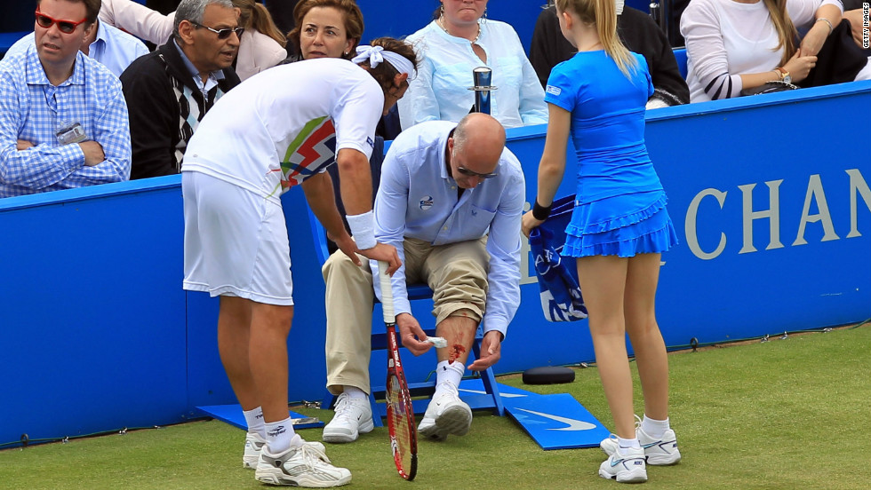 David Nalbandian shows his concern after line judge Andrew McDougall is left with a gashed leg.