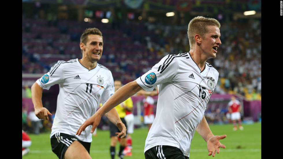 Lars Bender of Germany celebrates with Miroslav Klose after scoring the team's second goal against Denmark in L'viv, Ukraine, on Sunday, June 17.