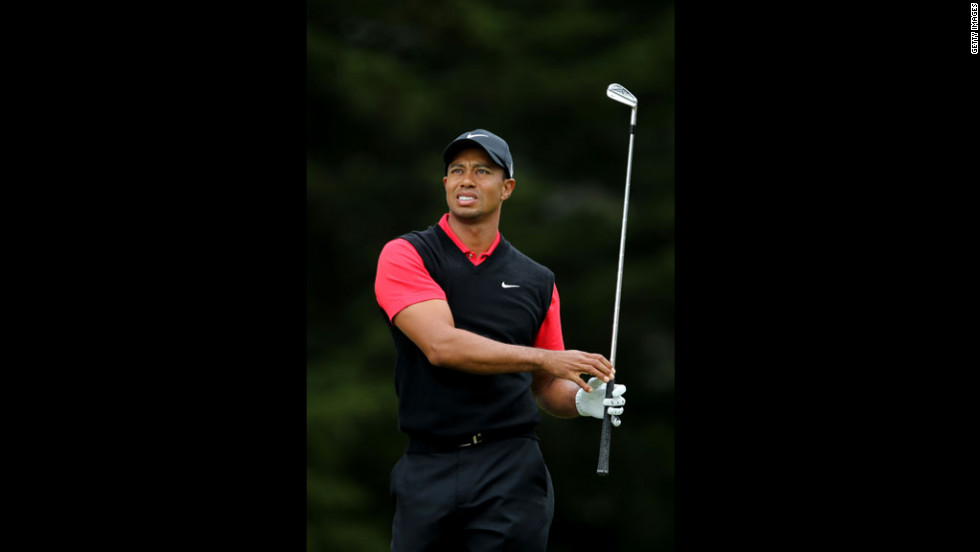 Tiger Woods of the United States watches his tee shot on the third hole.
