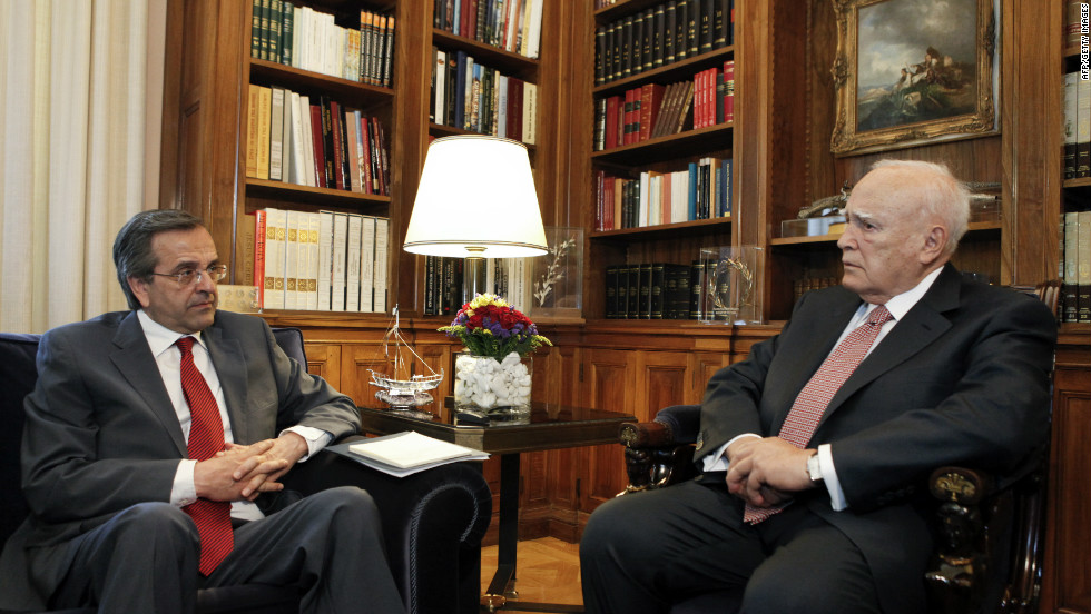 Greek President Karolos Papoulias, right, meets New Democracy leader Antonis Samaras before he receives a mandate to form a government on June 18 in Athens.
