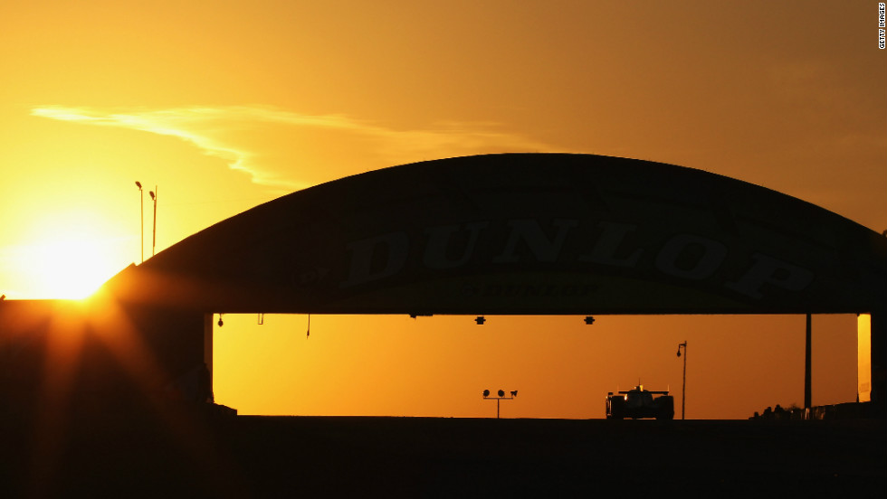 The Audi R18 Etron Quattro speeds around the Circuit de la Sarthe in north-west France as the sun goes down on Saturday.