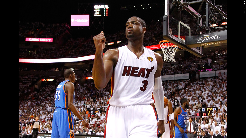Dwyane Wade walks off court in the first half.