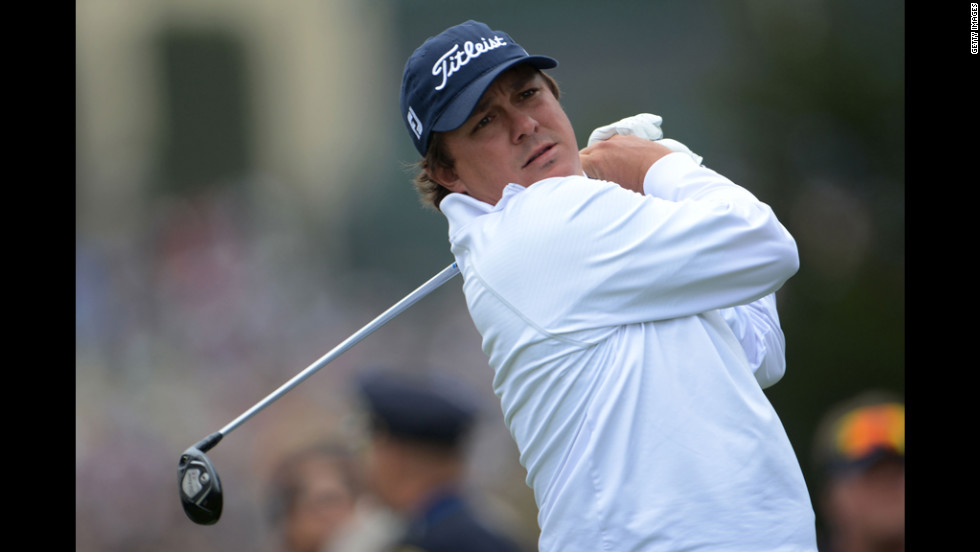 Jason Dufner of the United States watches his tee shot on the fourth hole.