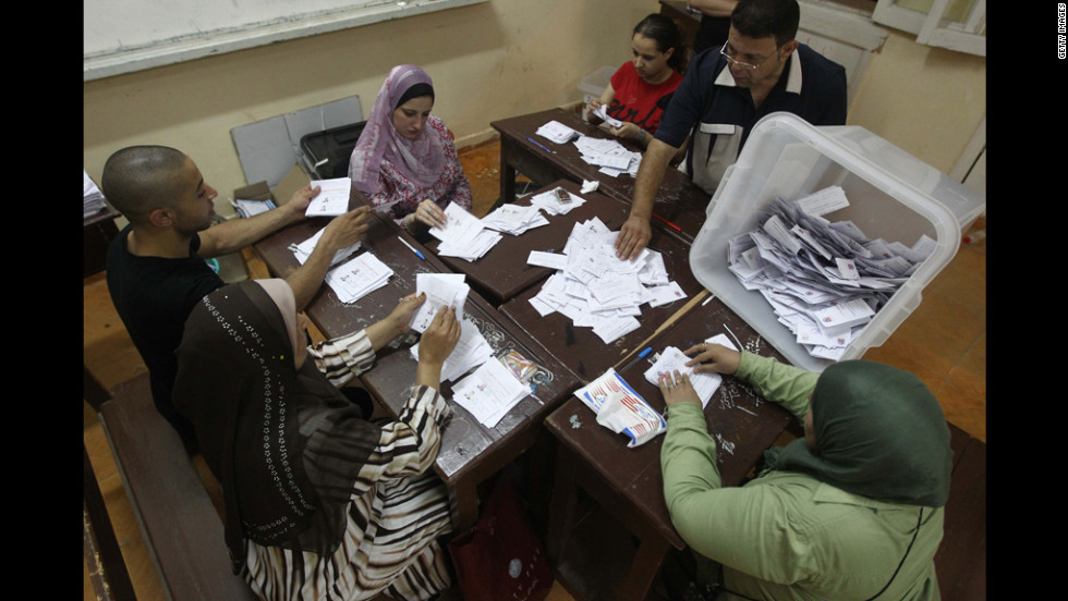 Egyptian election officials count ballots at a polling station in Cairo on Sunday, June 17. The official vote count was scheduled to be finished Monday.