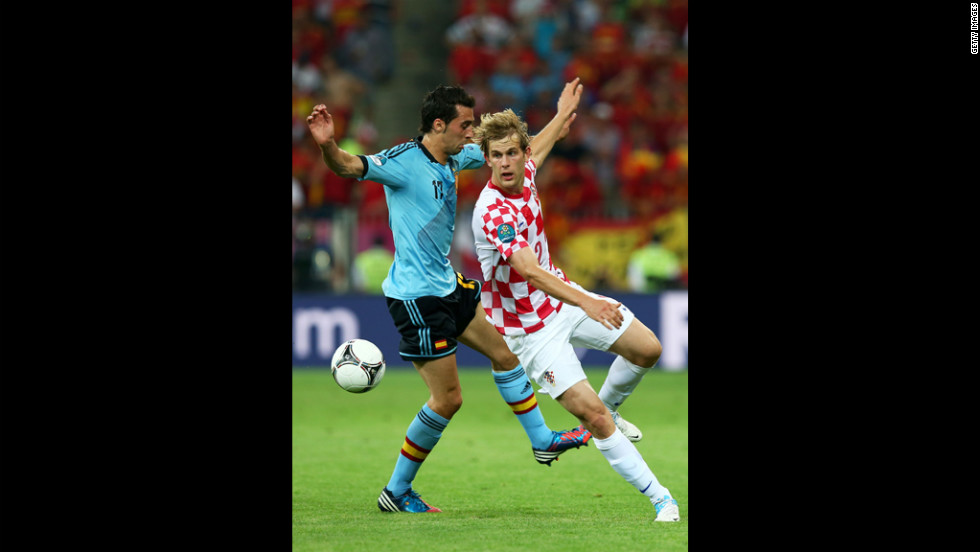 Spain's Alvaro Arbeloa and Croatia's Ivan Strinic fight for the ball during the group C match at Municipal Stadium in Gdansk, Poland, on Monday, June 18.