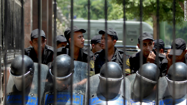 Egyptian riot police stand outside the parliament as protesters gather in Cairo on Tuesday.