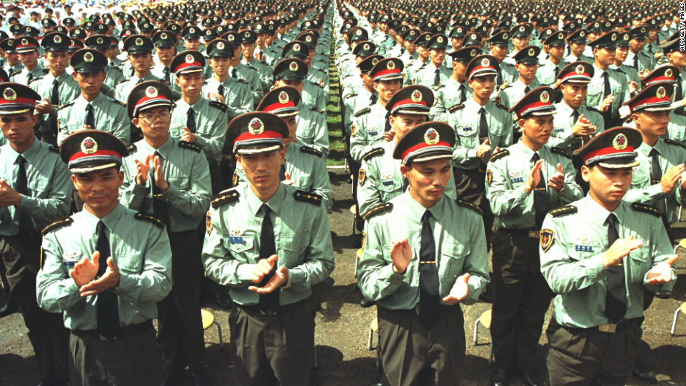 Hong Kong Garrison People's Liberation Army soldiers applaud during a farewell ceremony attended by the Chinese Central Military Commission in Shenzhen, China, on June 30, 1997.  The soldiers entered Hong Kong before the change of sovereignty became effective at midnight.