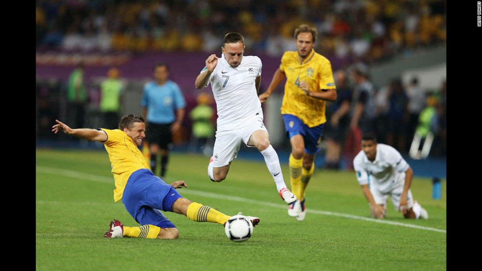 Franck Ribery of France is tackled by Anders Svensson of Sweden during the match between Sweden and France.