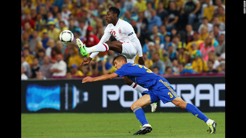 Danny Welbeck of England beats Yevhen Khacheridi of Ukraine to the ball during the match between England and Ukraine.