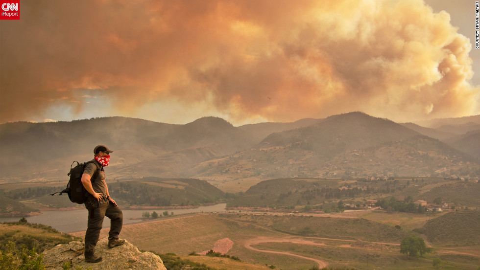 "CNN iReporter Bryan Maltais of Fort Collins, Colorado, took this picture of the Colorado fire from the cliffs above Horsetooth Reservoir in Larimer County. He started documenting the situation on June 10. ""Many people I know have been brought to tears for the people who have lost their homes, and for the destruction of so much forest,"" he said."