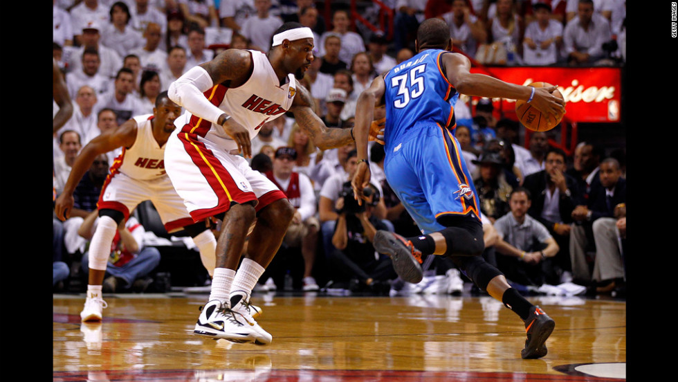 LeBron James, No. 6 of the Heat, defends in the first quarter against Kevin Durant, No. 35 of the Thunder.