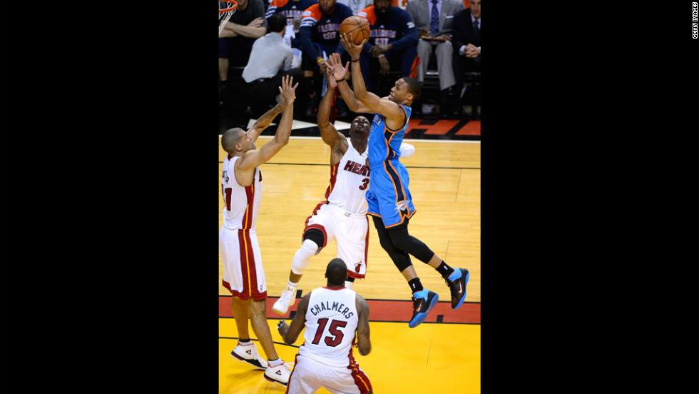 "Russell Westbrook, No. 0 of the Thunder, drives for a shot in the first quarter against Dwyane Wade, No. 3; Shane Battier, No. 31; and Mario Chalmers, No. 15, of the Heat. View photos from <a href=""http://www.cnn.com/2012/06/17/us/gallery/nba-finals-game-three/index.html"">Game three of the NBA Finals</a>."