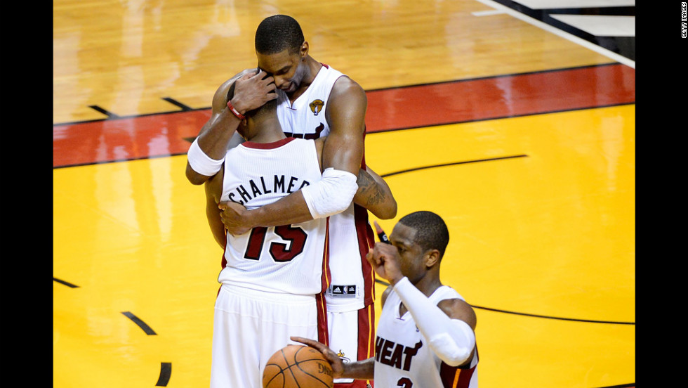 Mario Chalmers, Chris Bosh, top, and Dwyane Wade of the Miami Heat celebrate after defeating the Oklahoma City Thunder 104-98 in Game 4 of the 2012 NBA Finals on Tuesday, June 19.