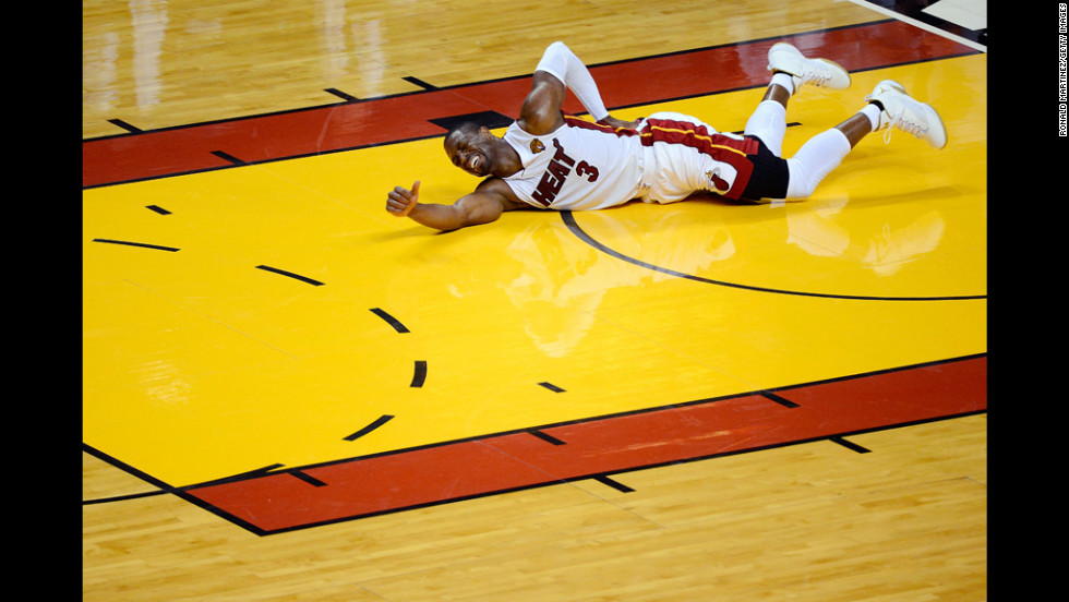 Dwyane Wade of the Miami Heat grabs his back as he lies on the court in pain during the second quarter of the Heat's NBA Finals game Tuesday against the Oklahoma City Thunder in Miami.
