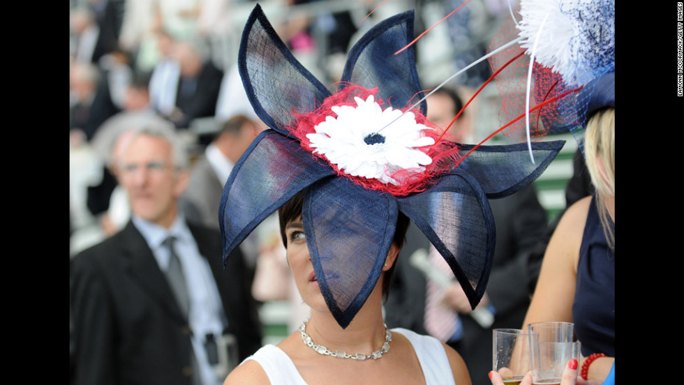 Racegoers attend the first day of the Royal Ascot horse-racing festival Tuesday at Ascot Racecourse in England.
