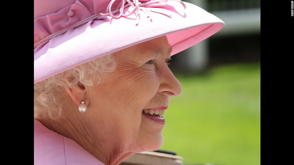Queen Elizabeth II smiles as she arrives.