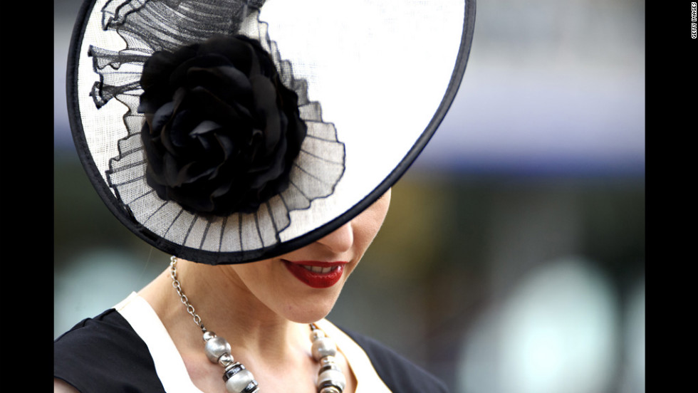 A woman in a striking hat attends day one of the races.
