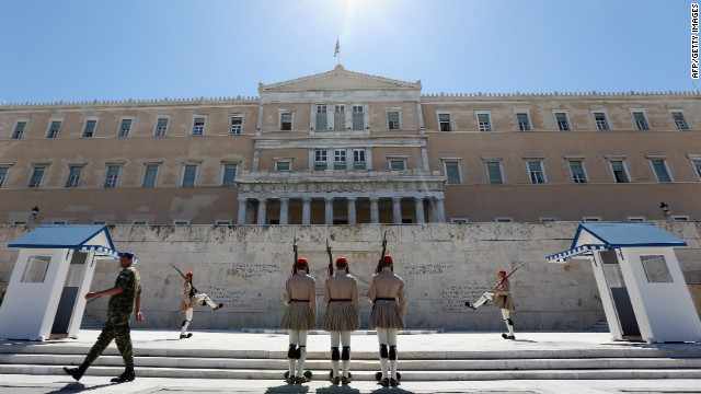 ATHENS, GREECE - JUNE 18: The Changing of the Guard ceremony takes place in front of the Greek Parliament building on June 18, 2012 in Athens, Greece. The conservative, pro-bailout New Democracy party came in first winning 130 of the 300 seats in Parliament. The Greek electorate went to the polls yesterday in a re-run of the general election after no combinations of political parties were able to form a coalition government. (Photo by Oli Scarff/Getty Images)