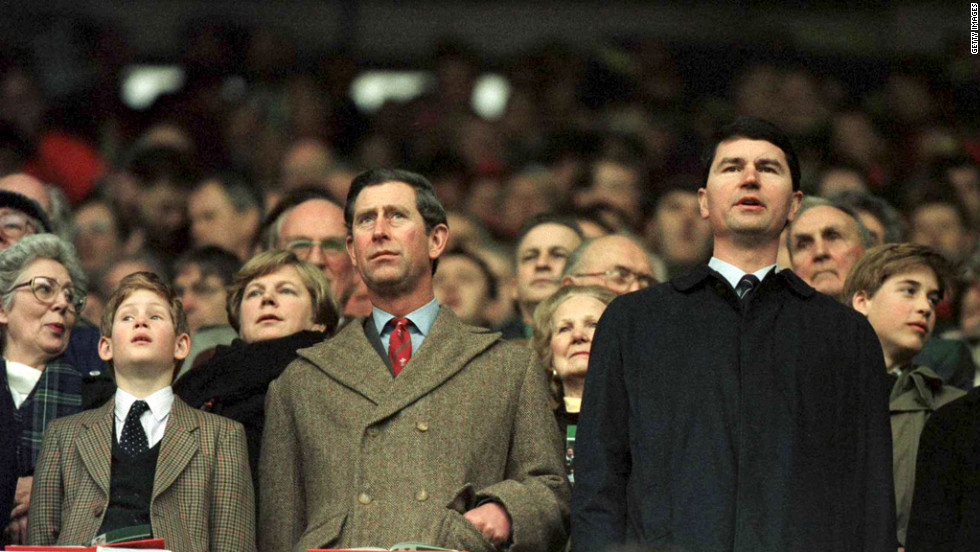 Prince Charles and Prince Harry, at left, stand for anthems as Prince William, right, looks around during the Wales-Scotland game in the 1996 Five Nations rugby championship.