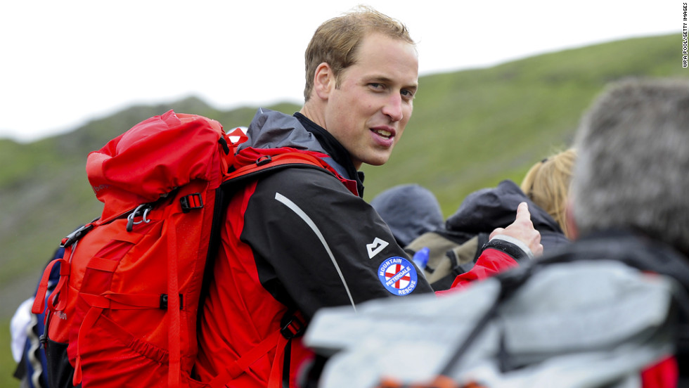 Prince William walks with a group of homeless people during a 2009 hike with Centrepoint, the United Kingdom's largest youth charity for the homeless. William became the patron of the organization in 2005.